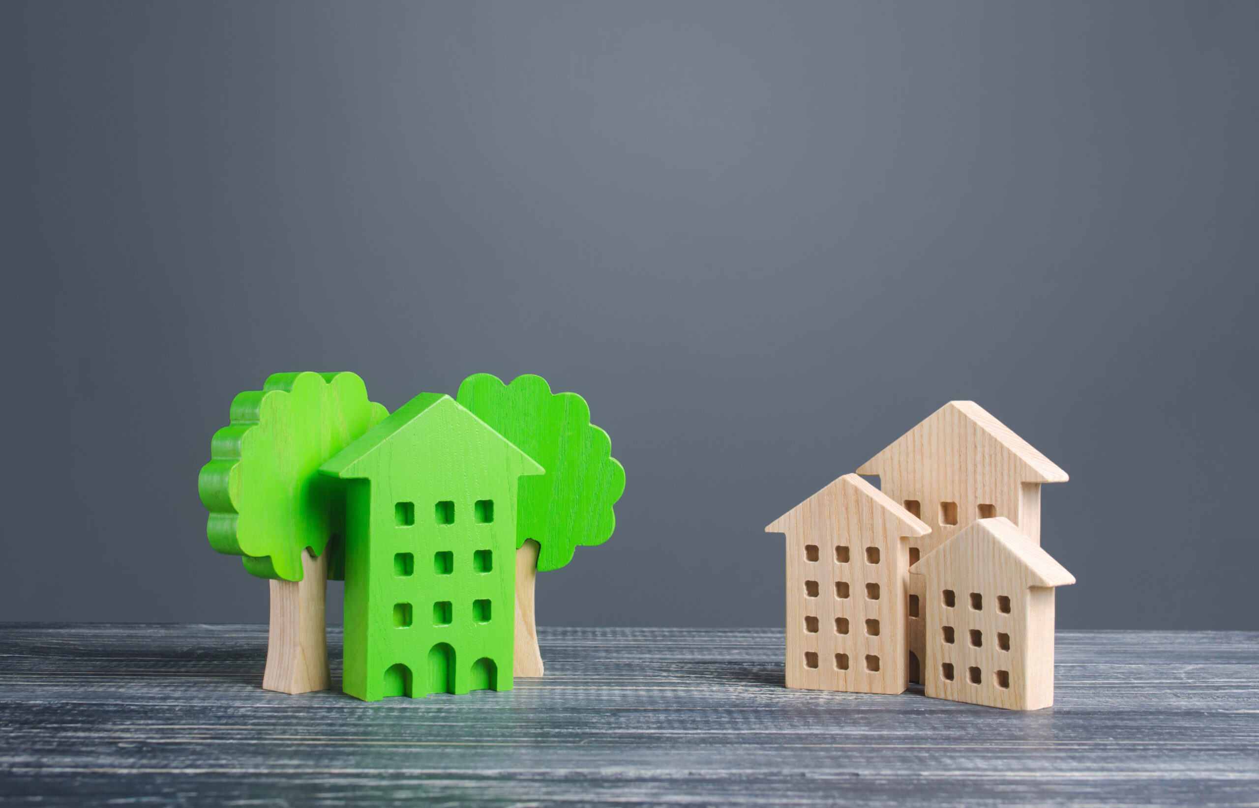 Green,House,With,Trees,And,Ordinary,Residential,Buildings.,Energy,Efficiency,